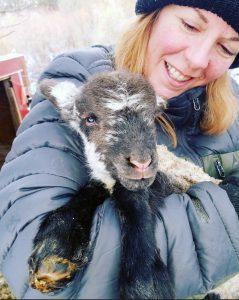 Leah Myers holding a lamb